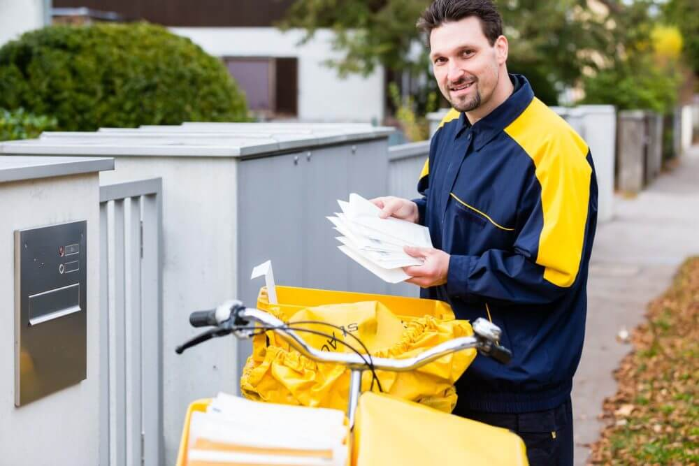 postman carrying letters